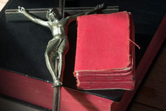 Metal Crucifix with Two Holy Bibles Royalty Free Stock Images