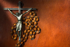 Metal Crucifix with Wooden Rosary Beads Royalty Free Stock Image
