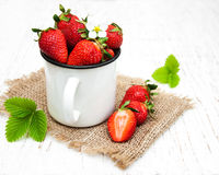 Metal cup with strawberries Stock Image
