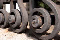 Detail of a heavy and metal gate. Metal curls with sequency of geometric spirals Royalty Free Stock Image