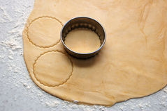 Metal cutter cutting out circles of pastry for jam tarts Stock Photo