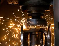 Metal-cutting. Metal working cutting at manufacture of a component part of a propeller shaft of the car Stock Photos
