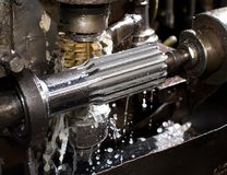Metal-cutting. Metal working cutting at manufacture of a component part of a propeller shaft of the car Stock Image