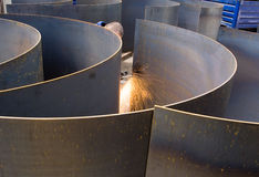 Metal cutting. Cutting and preparing sheet metal at an engineering works Stock Image