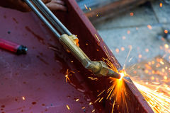 Metal Cutting With Acetylene Gas. Workman is working by use torc Stock Photo