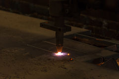 Metal cutting with acetylene torch by auto cutting machine close. Up on low light Stock Images
