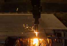 Metal cutting with acetylene torch by auto cutting machine close. Up on low light Royalty Free Stock Photo