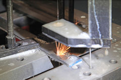 Metal cutting electric spark method Royalty Free Stock Photo