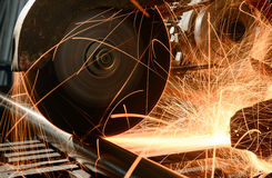 Metal cutting. Industrial worker cutting and welding metal with many sharp sparks Stock Images