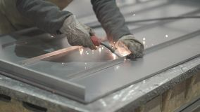 Metal cutting manually and automatic line welding of parts. Manual metal cutting and automatic welding line of parts at the factory stock footage