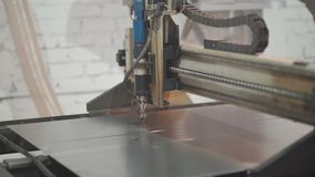 Metal cutting manually and automatic line welding of parts. Manual metal cutting and automatic welding line of parts at the factory stock video footage