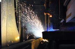 Metal cutting process using plasma cutting machine stock photography