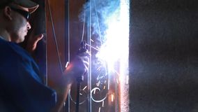 Metal Cutting Video. Worker cutting metal with many sharp sparks Full HD Video stock video