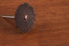 The Metal cutting wheel  on the wood Royalty Free Stock Image