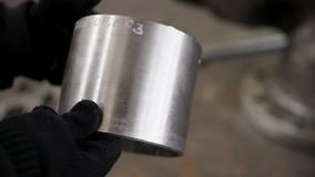 The metal cylinder. Detail of the gate in the hands of worker. Production of energy and pipeline valves stock footage