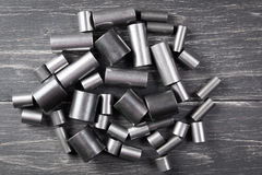 Metal cylinders on dark background. Metal cylinders - elements of the industrial roller driving chain on dark background Stock Images