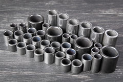Metal cylinders on dark background. Metal cylinders - elements of the industrial roller driving chain on dark background Stock Image