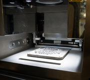 Metal 3D printers (DMLS). Direct metal laser sintering (DMLS) is an additive manufacturing technique that uses a Ytterbium fibre laser fired into a bed of Stock Images