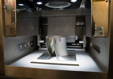 Metal 3D printers (DMLS). Direct metal laser sintering (DMLS) is an additive manufacturing technique that uses a Ytterbium fibre laser fired into a bed of Royalty Free Stock Photos