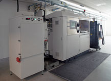 Metal 3D printers (DMLS). Direct metal laser sintering (DMLS) is an additive manufacturing technique that uses a Ytterbium fibre laser fired into a bed of Stock Photography