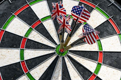 Metal darts have hit the red bullseye on a dart board. Darts Gam Royalty Free Stock Photography