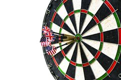 Metal darts have hit the red bullseye on a dart board. Darts Game. Darts arrow in the target center darts in bull`s eye close up i. Metal darts have hit the red Stock Photography