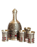 Metal decanter and cups Royalty Free Stock Photos