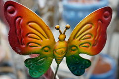 Metal decorative butterfly. Souvenirs, decoration, garden furniture, multicolored Stock Images