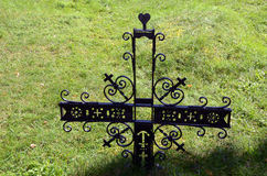 Metal decorative cross in meadow partisan cemetery Stock Images