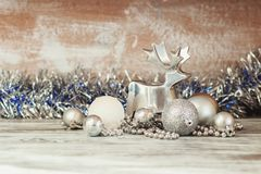 Metal decorative deer and different New Year decorations royalty free stock photos