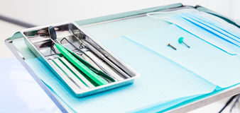 Metal dental medical equipment tools on tray Stock Photography