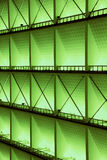 Metal design of an interior in a modern building, In green light. Royalty Free Stock Photo