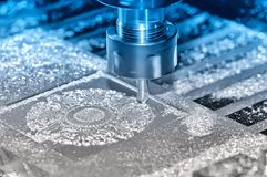 Metal detail on an industrial milling machine. Blue toning. Machining of a metal part on an industrial milling machine. On a surface of a detail there are royalty free stock photography