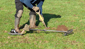 Metal Detecting. Digging a hole to retrieve signal metal detecting stock photo