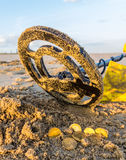 Metal detecting on the beach Royalty Free Stock Photos