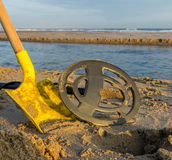 Metal detecting on a beach Stock Photography