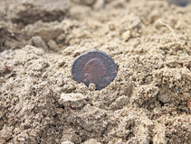 Metal detecting. Metal detector and spade with found coins in the sand royalty free stock photos