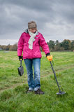 Metal Detecting. WORCESTER,UK-NOVEMBER 21 2010 :Woman with a metal detector searching in a field for buried metal stock photos
