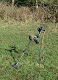 Metal Detector. Resting on spade in field stock images