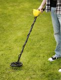 Metal Detector. Man using a metal detector on lawn stock photography