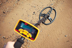 Metal detector in action Royalty Free Stock Image