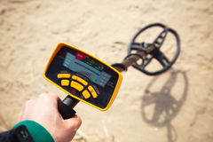 Metal detector in action. Closeup view stock images