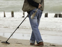 Metal detector on the beach. On the beach, man with metal detector Stock Photos