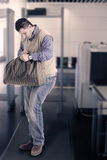 Metal Detector - Body Scanner. Photo of man putting his stuff together after metal detector check up stock photos