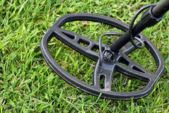 Metal detector on grass Stock Images