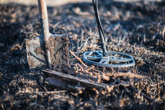 Metal detector, spade, and finding rusty metal. Recreation. Hobby. Royalty Free Stock Photography