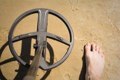 Metal detector in the sand. Metal detector treasure hunt in the sand stock photos