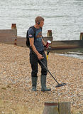 Metal detectorist. Photo of a metal detectorist scanning the beaches of whitstable in kent looking for treasure! photo taken 22nd july 2015 and ideal for hobbies royalty free stock photography
