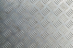 Metal diamond plate in silver color background Stock Photos