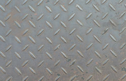 Metal diamond plate in silver color background Royalty Free Stock Images